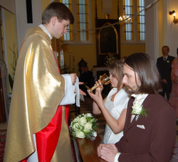 Ejdzej_and_iric_wedding_communion_2